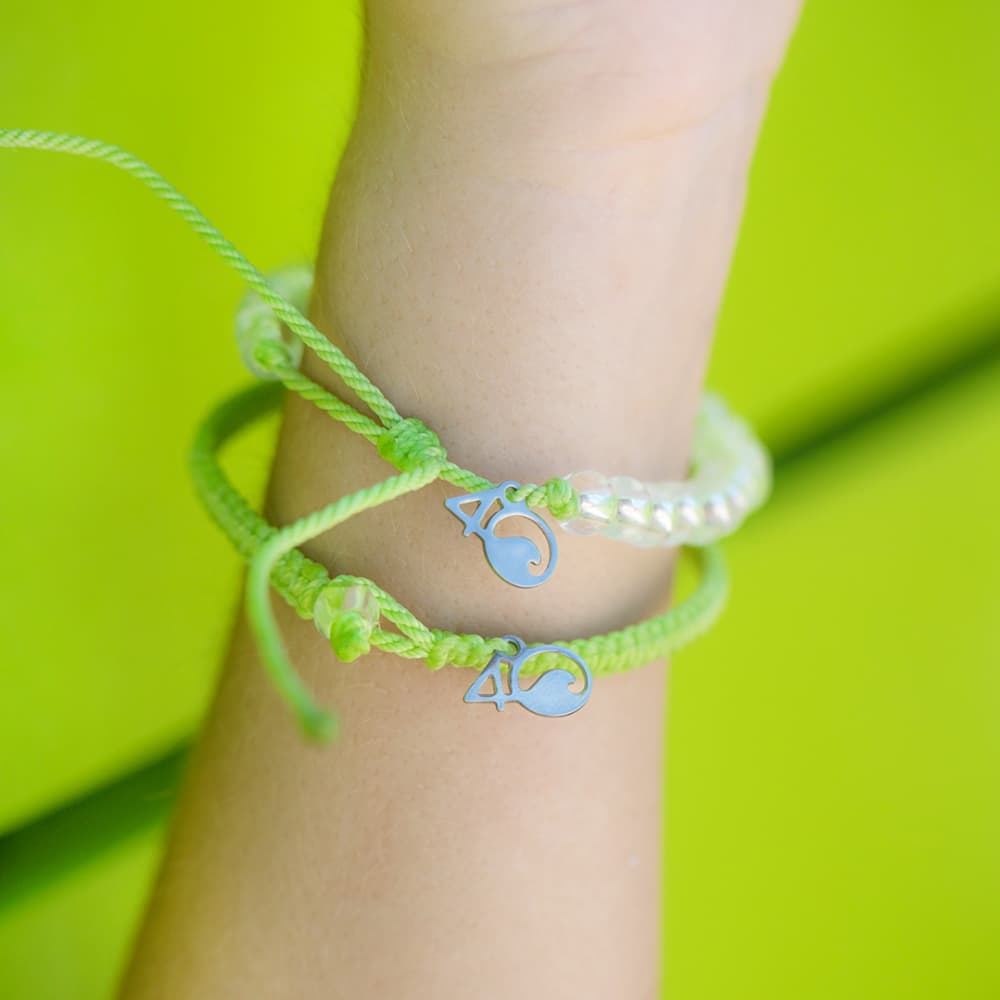 4ocean Sea Turtle Beaded and Braided Bracelet 2-Pound Pack on a wrist