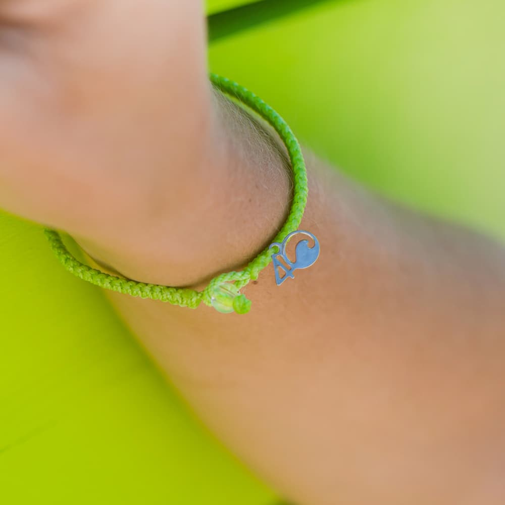 4ocean Sea Turtle Braided Bracelet on a wrist