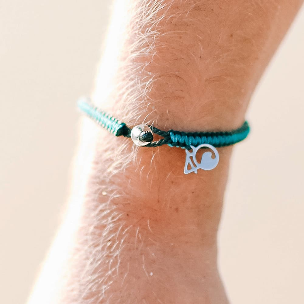 4ocean Sea Otter Braided Bracelet on a Wrist Closeup