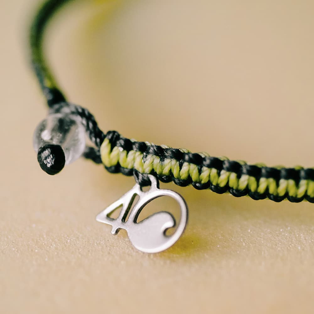 4ocean Penguin Black and Yellow Braided Bracelet Closeup