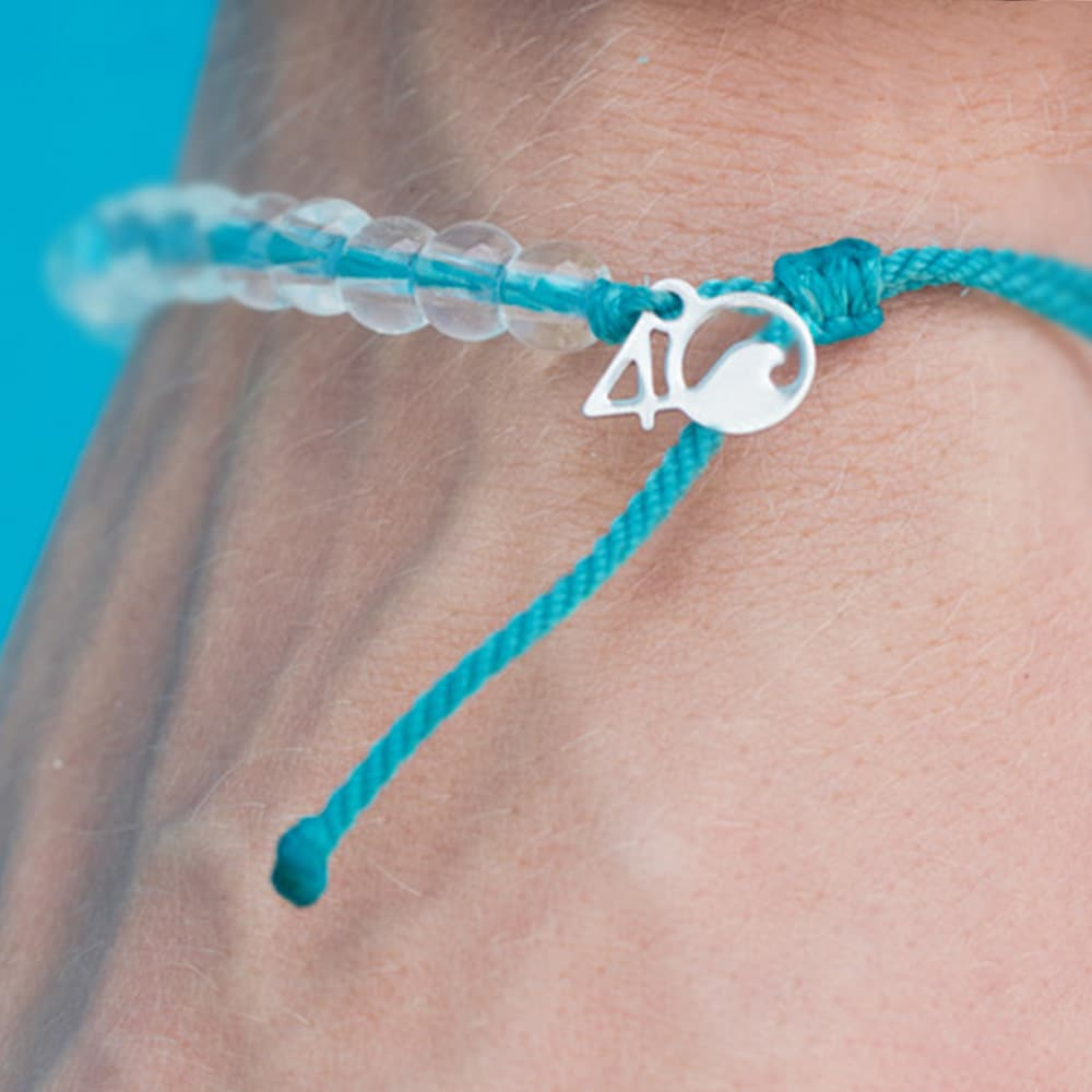 4ocean White-Sided Dolphin Beaded Bracelet on a mans wrist