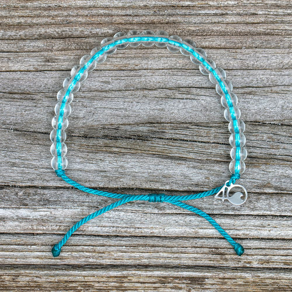 4ocean White-Sided Dolphin Beaded Bracelet on a wooden plank