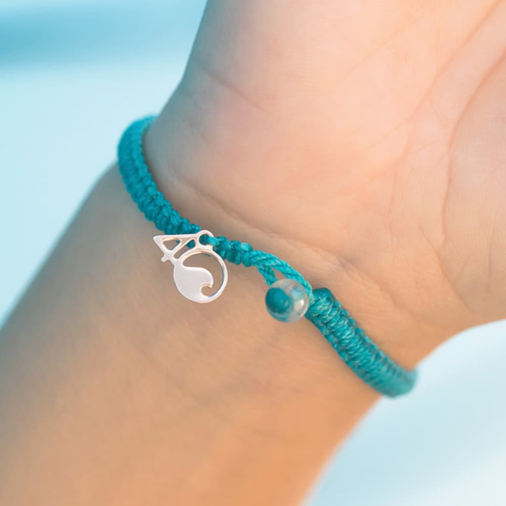 4ocean White-Sided Dolphin Braided Bracelet on a wrist