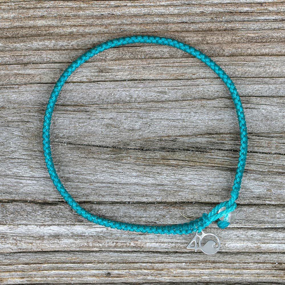 4ocean White-Sided Dolphin Braided Bracelet on a wooden plank