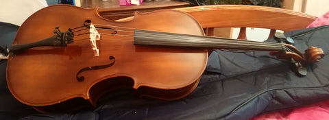 Vintage 1/4 - 1/8 size cello, unbranded, quite nice.  New bridge and Prelude strings.