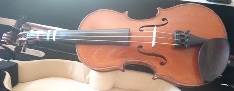 Antique 1/2 size violin.  Dominant strings, Glasser tailpiece.  Violin only.