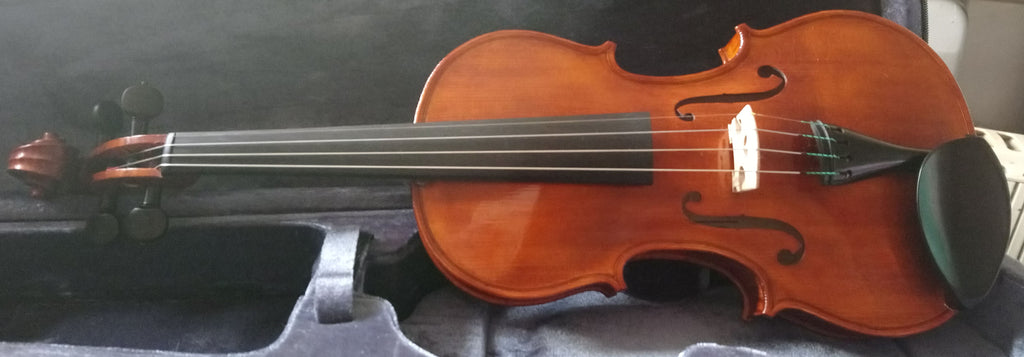 High quality violin hand varnished and set up in England.  4/4 right handed only.  Exclusive to Elida Violins.