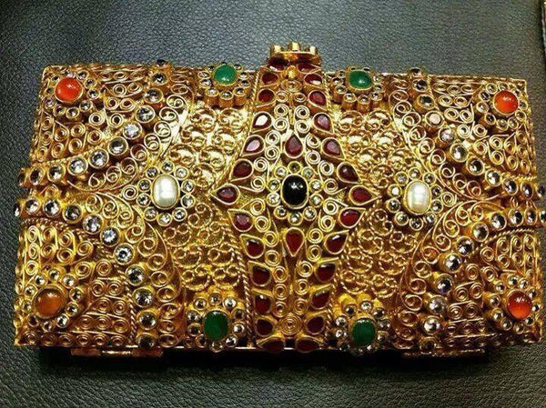 Gold plated clutch.