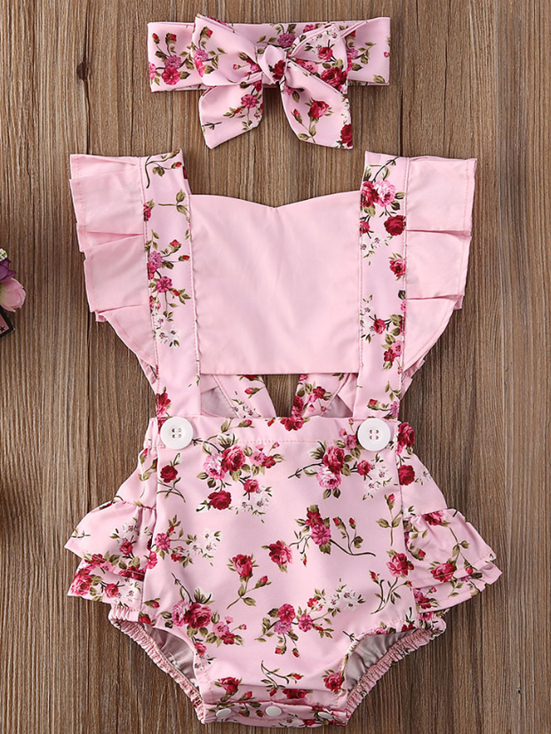 Baby overall style onesie with ruffles on the bum that ties in the back and a matching headband pink