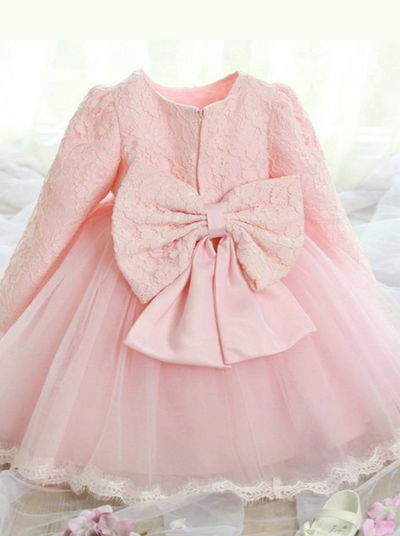 Baby Spring dress has a long-sleeved lace bodice  and layered tulle skirt with a big bow the back
