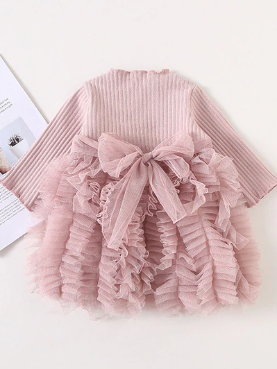 Baby Spring sweater dress features long sleeves with a ruffled tulle skirt and front bow