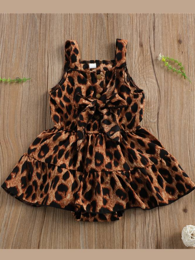 Baby romper dress with leopard print and front snap closure