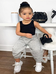 Girls black cropped tank top and loose grey jogger pants