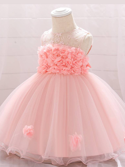 The dress has a bodice with flower applique and tulle skirt