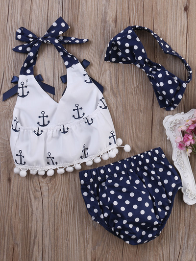 Baby set features a white halter top with an anchor print and adjustable straps with polka dot bloomer shorts