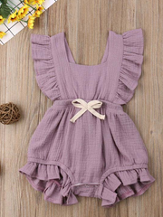 Baby bohemian Overall style romper onesie that ties in the back and has a drawstring at the waist. Little ruffled adorn the shoulder and short hem lilac