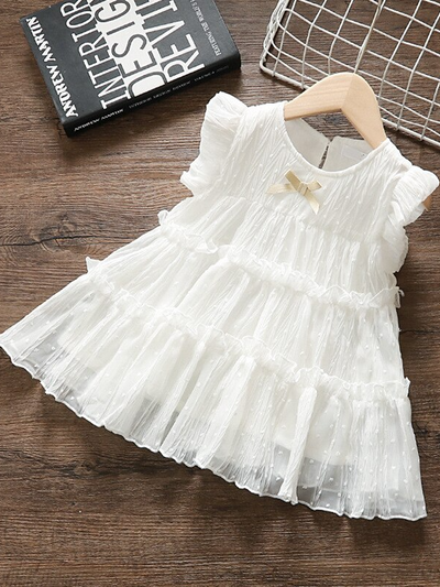 Baby swiss tulle dress has delicate ruffles and a little bow at the front