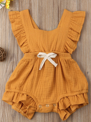 Baby bohemian Overall style romper onesie that ties in the back and has a drawstring at the waist. Little ruffled adorn the shoulder and short hem orange