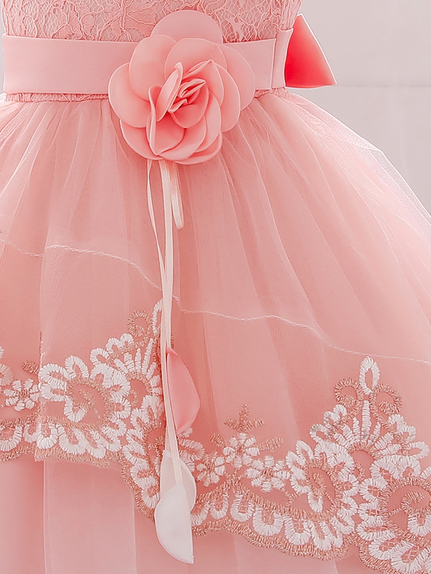 Baby dress has embroidered tulle overlay bodice and hi-lo tulle overlay skirt, removable big bow accent at the back and flower applique at the front