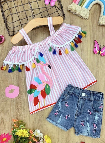 Girls flamingo print top adorned with multicolor tassels on the ruffles and matching patched, ripped denim shorts 2T-12Y