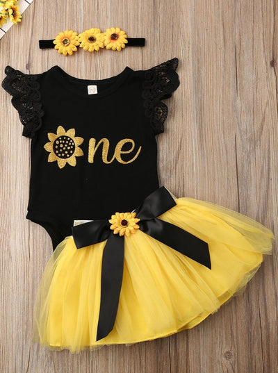 "Baby set has a onesie with ruffled lace sleeves and ""One"" printed, a tutu skirt with sunflower sash, and a matching sunflower headband"