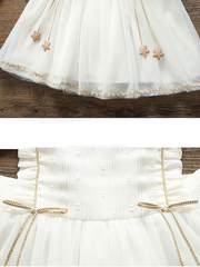 Baby Spring Baby tulle dress has delicate gold star details-white-tulle-ruffled