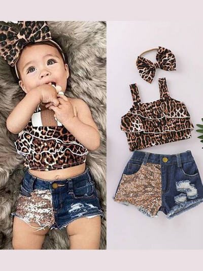 Baby set features a ruffled cropped top with leopard print and distressed denim shorts with sequin patch, comes with a matching headband