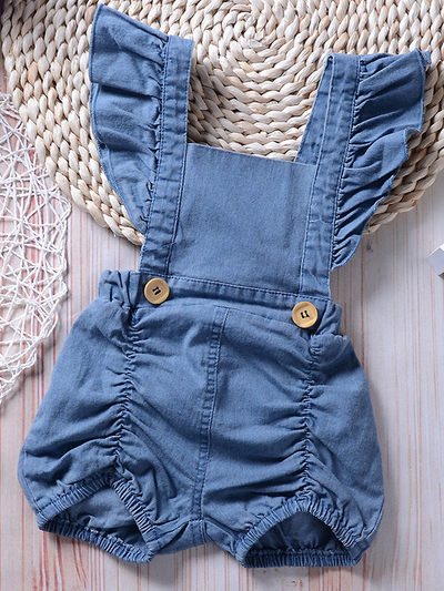 Baby overall style romper onesie has ruffled shoulder straps that tie on the back. has 2 little buttons on the front to make it even more stylish