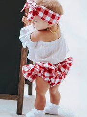 Baby set features an eyelet off-shoulder top and checkered skirted bloomers with a headband
