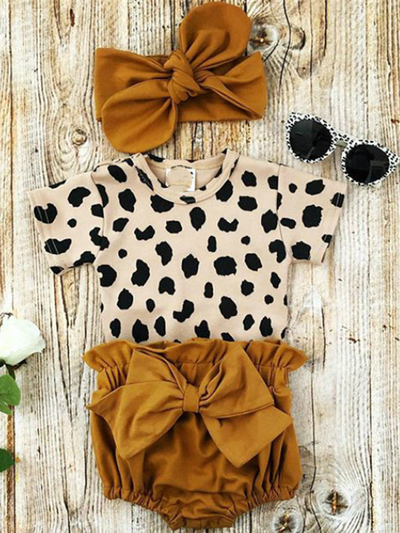 Baby set features a short-sleeved onesie with animal print, bloomer shorts with a bow, and matching headbands