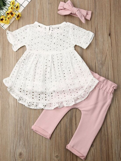 Baby set features an eyelet hi-lo tunic and belted leggings