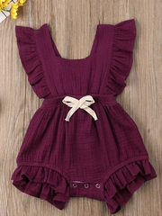 Baby bohemian Overall style romper onesie that ties in the back and has a drawstring at the waist. Little ruffled adorn the shoulder and short hem burgundy