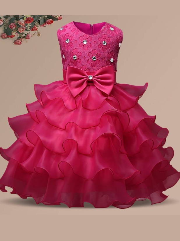Baby princess dress has a floral lace bodice with rhinestone details, a bow belt at the waist, and a multi-layered tulle skirt-hot pink