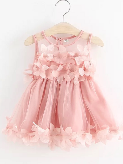 Baby  tulle dress has flower applique on the bodice and dress hem pink
