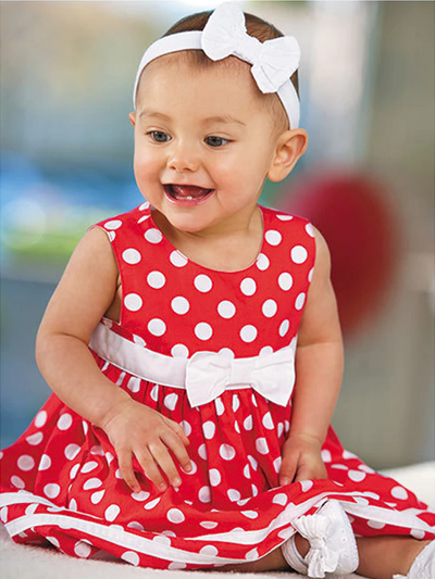 Baby red summer dress has a cute white polka dot print, a white bow at the waist and comes with matching bloomers