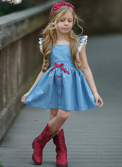 Girls spring blue lightweight overall style denim dress has crochet details on the shoulder strap, front buttons on the skirt and a cute sash 2T-10Y