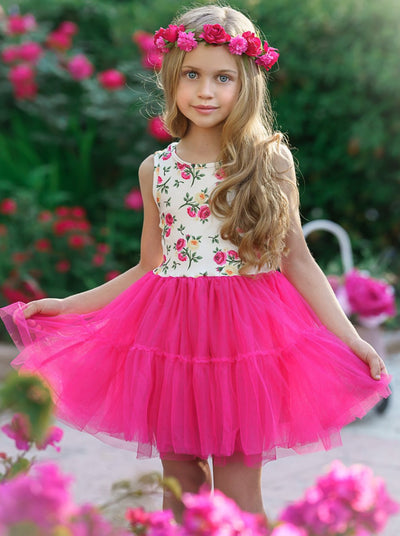 Girls dress has a white floral bodice with a full burgundy tutu skirt