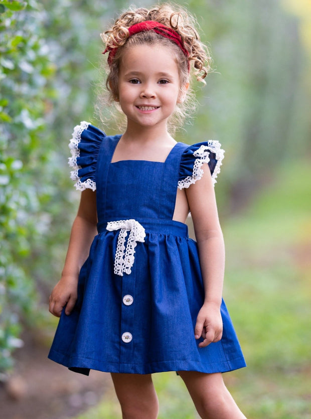 Girls spring navy lightweight overall style denim dress has crochet details on the shoulder strap, front buttons on the skirt and a cute sash 2T-10Y
