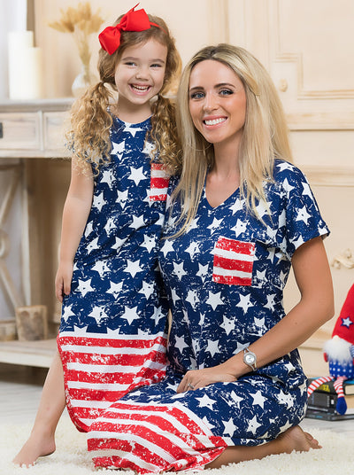 Mommy and me navy maxi dress features white stars and a red/white striped hem