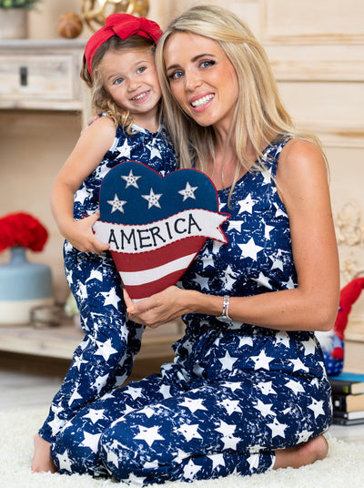 Mommy and Me navy jumpsuit features white stars, front pockets, and drawstring at the waist