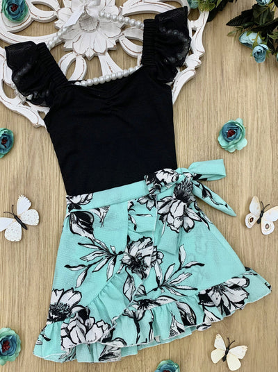 Girls Spring black ruched, v-neck top with dotted tulle sleeves and a mint and black floral ruffled wrap skirt that ties at the waist 2T/3T to 10Y/12Y