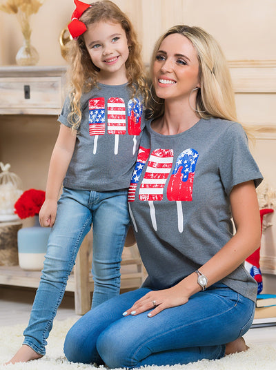 Mommy and Me grey top features patriotic popsicles graphics with a knot at the waist