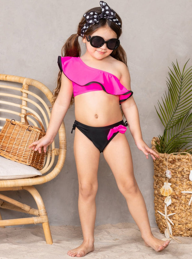 Girls hot pink One Shoulder Ruffled Top with black hem and black Bottoms with hot pink bow Two Piece Swimsuit 3T-12Y