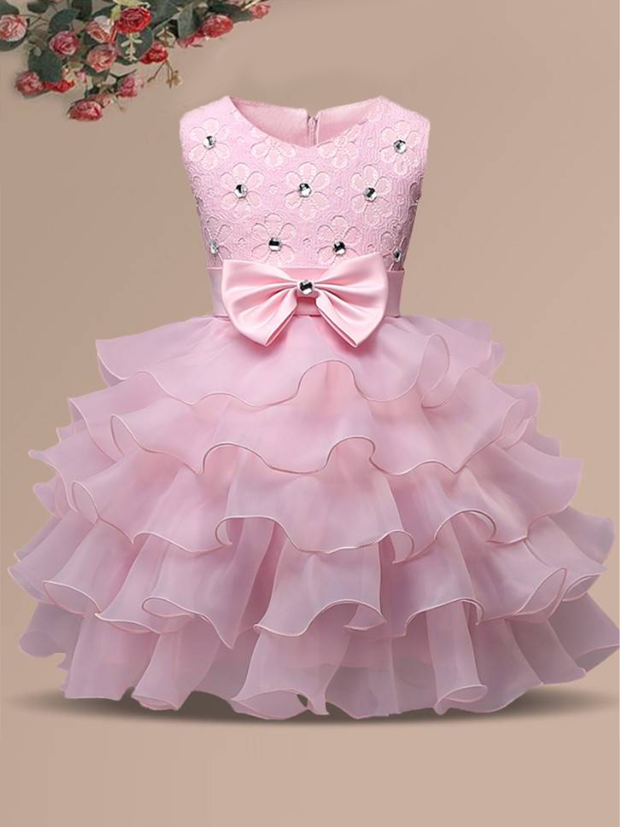 Baby princess dress has a floral lace bodice with rhinestone details, a bow belt at the waist, and a multi-layered tulle skirt-pink