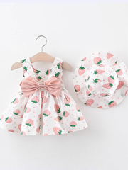 Baby dress has an adorable strawberry print and a large bow at the back and comes with a matching hat pink