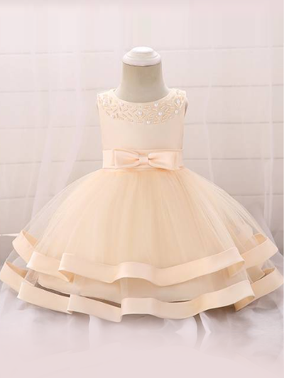 Baby dress features beautiful beads on the bodice, voile with satin hem-creme