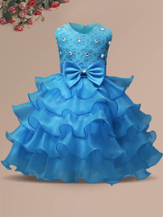 Baby princess dress has a floral lace bodice with rhinestone details, a bow belt at the waist, and a multi-layered tulle skirt-light blue