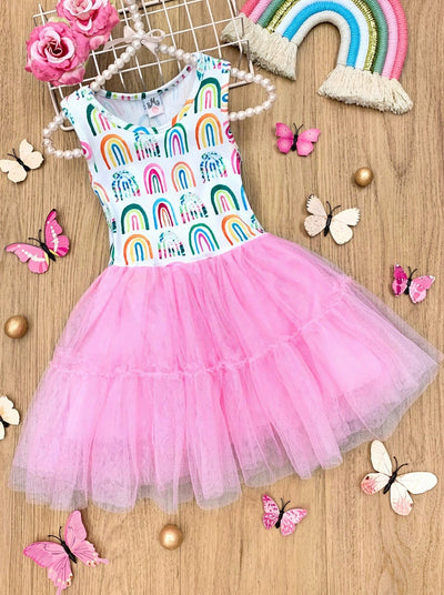 Girls dress has a white bodice with rainbow prints and a full pink tutu skirt