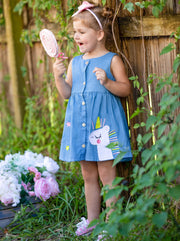 Girls denim dress has a unicorn and stars applique and closes at the front with buttons