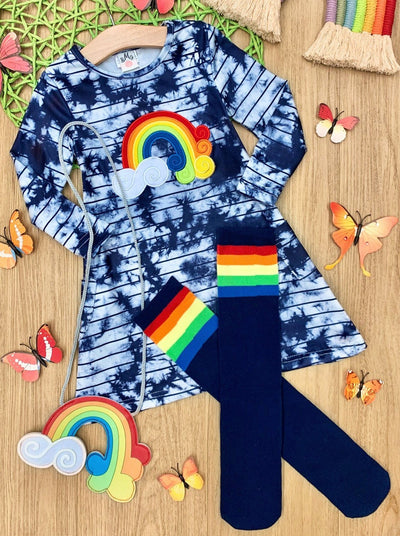 Girls set features a tie dye dress with rainbow and cloud applique with knee-high socks and a matching purse